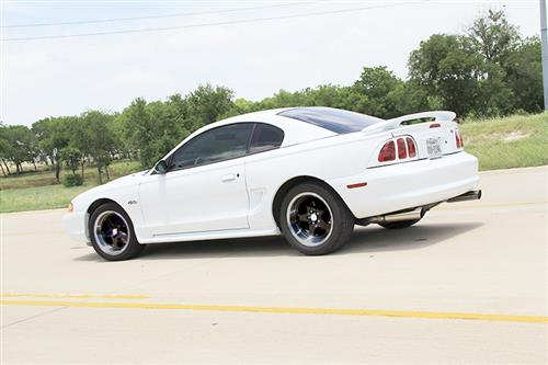 Mustang SC Staggered Wheel & Tire Kit - 17x9/10 Black W/ Machined Lip (94-04) Nitto NT555